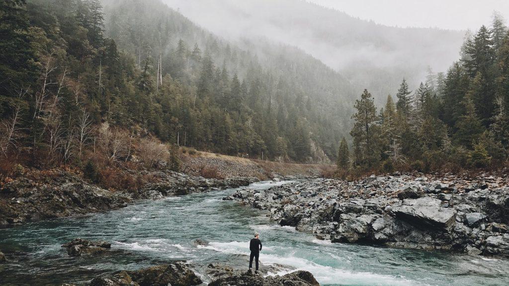 man near a river