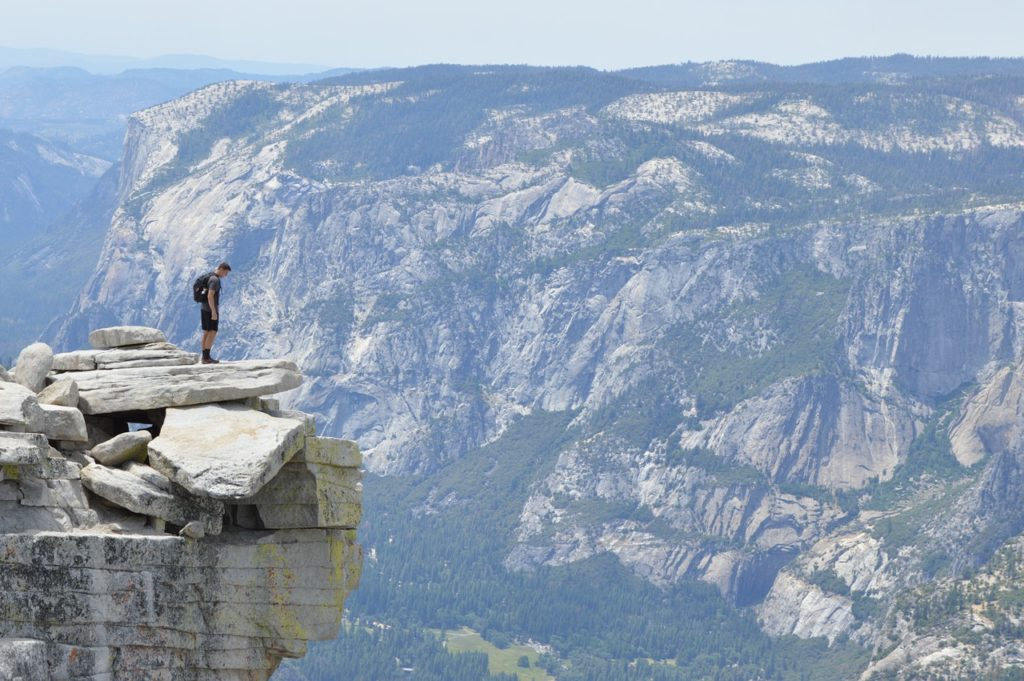 man standing at the edge of the mountain