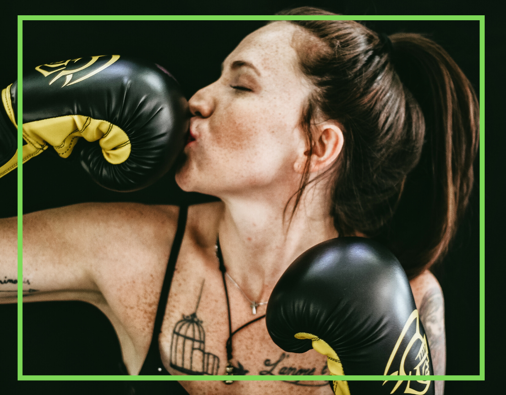 Girl Kissing Boxing Gloves