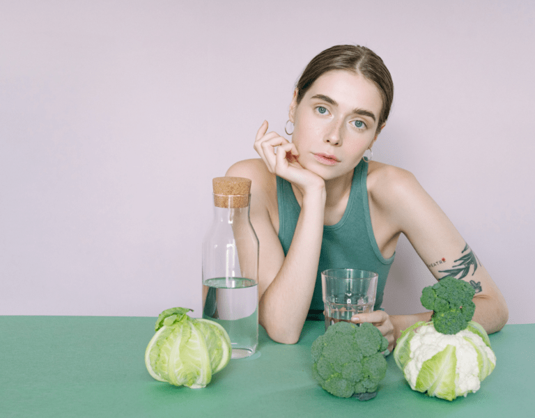 woman making detox water