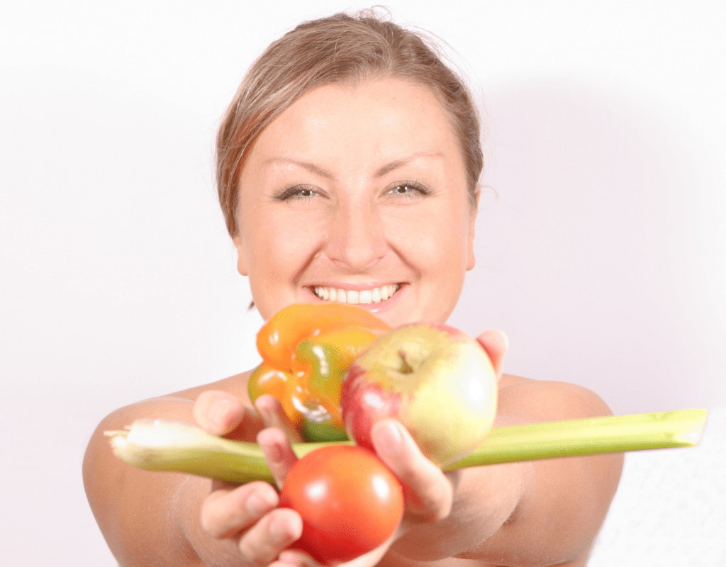 woman holding fruits & vegetables